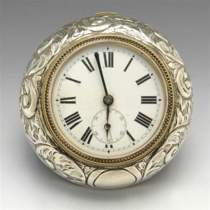 A turn of the century silver mounted bedside clock.