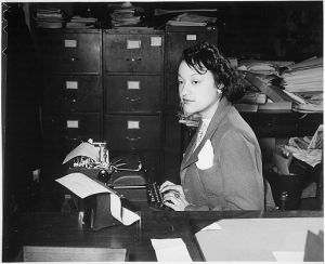 -Miss_Clara_Camille_Carroll...,_contributes_her_bit_to_the_war_effort_in_her_daily_work._She_is_one_of_the_thousands_of_-_NARA_-_535813